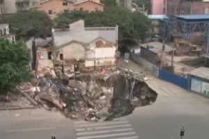 Giant Sinkhole Gobbles Up Building in China   1Funny.com