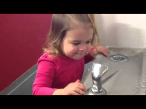 Little Girl at a Water Fountain