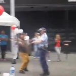 Older Man Dancing with a Police Woman