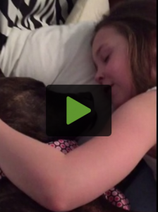 Little Girl Preciously Serenades Foster Dog