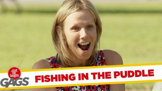 Kid-Catches-Huge-Fish-from-a-Puddle