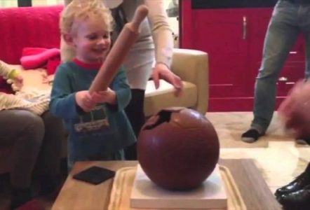 Kid-Uses-Rolling-Pin-to-Smash-Giant-Chocolate-Soccer-Ball-and-Dads-Hand