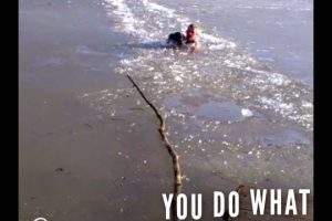 Man-Breaks-Through-Icy-Water-With-His-Hands-To-Rescue-Trapped-Dog