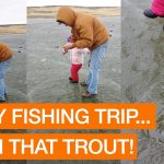 Family Catch Rainbow Trout During Ice Fishing Trip