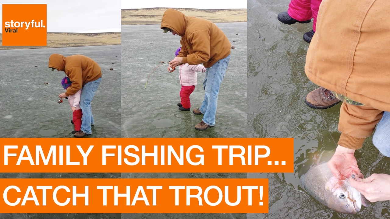 Family Catch Rainbow Trout During Ice Fishing Trip ...