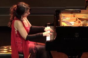Brazilian-pianist-Eliane-Rodrigues-LITERALLY-taking-the-performance-below-the-stage