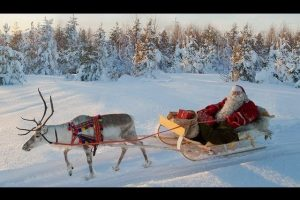 Santa-Claus-and-Reindeer-on-the-road-Lapland-Finland-Rovaniemi-Father-Christmas-for-kids