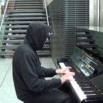 Man in Hoodie Plays the Piano Then Walks Away