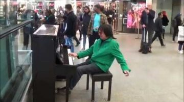 Guy Rocks Out Amazing Grace to a Crowd