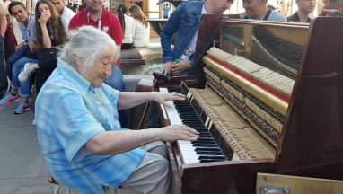 Old Woman Playing a Street Piano